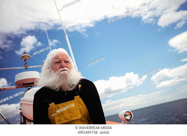Fisherman sitting on deck