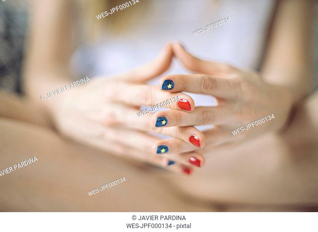 Hands of woman with different varnished nails