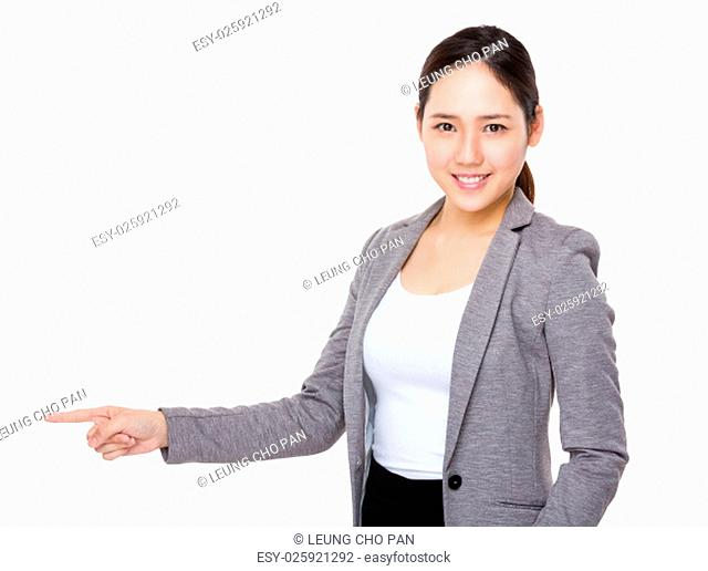 Young Businesswoman showing finger point aside
