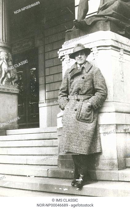 Portrait of a man standing outside