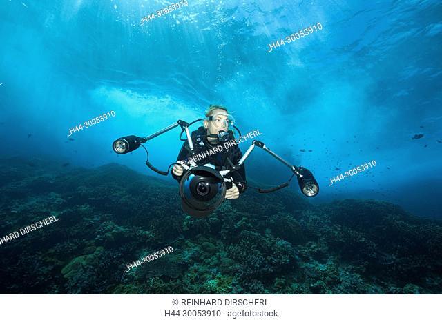 Scuba diver in surf zone, Christmas Island, Australia