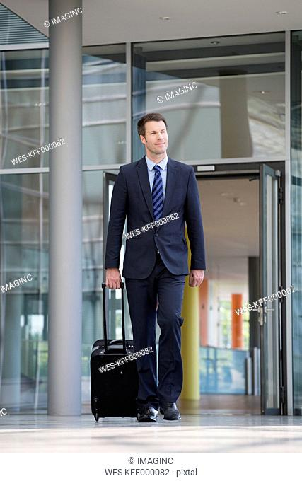 Germany, Hannover, Businessman walking with briefcase at terminal