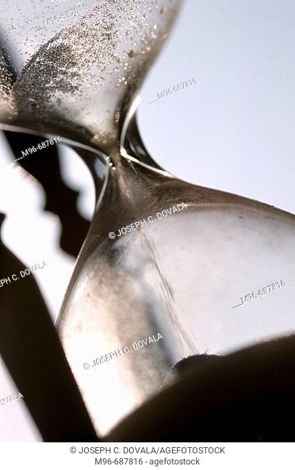 Time draining away, sand hour glass