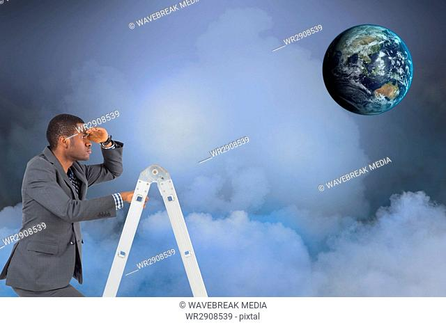 Digital composite image of businessman on ladder looking at globe in sky