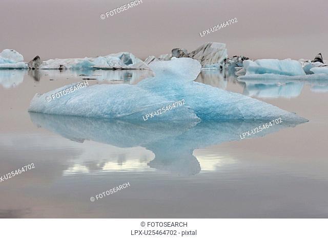 Iceberg detail with reflection, Jokulsarlon lagoon sunrise, Icel