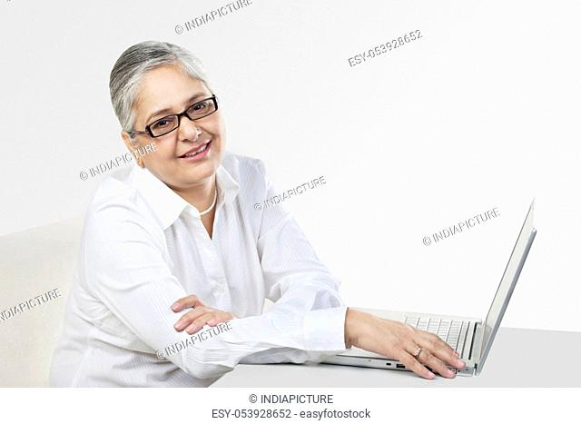Old woman with a laptop