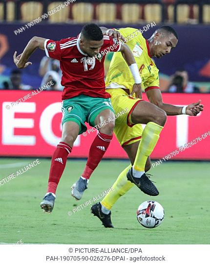 05 July 2019, Egypt, Cairo: Morocco's Youssef En-Nesyri (L) and Benin's Olivier Verdon battle for the ball during the 2019 Africa Cup of Nations round of 16...