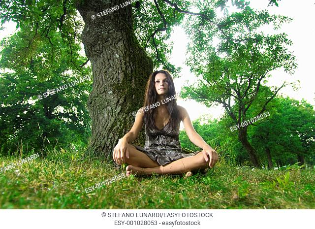 Beautiful young woman sitting under a tree  Taken in Lipica, Slovenia  Concept: teenagers and nature