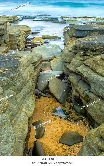 Rocks and waves at Point Cartwright beach in the afternoon. Sunshine Coast, Queensland