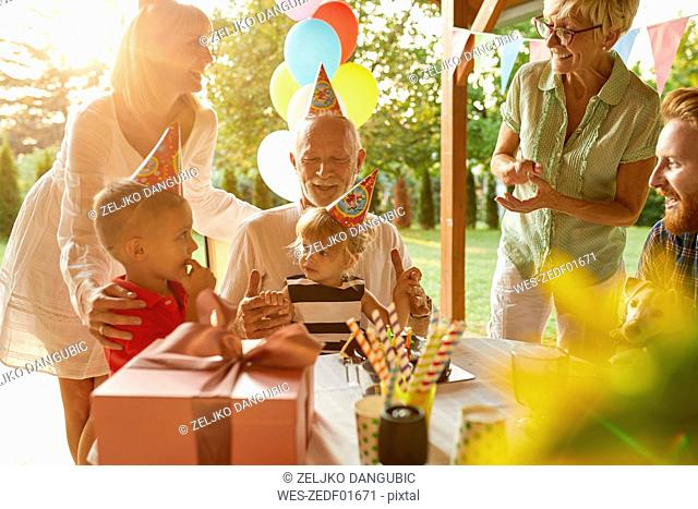 Happy extended family on a garden birthday party