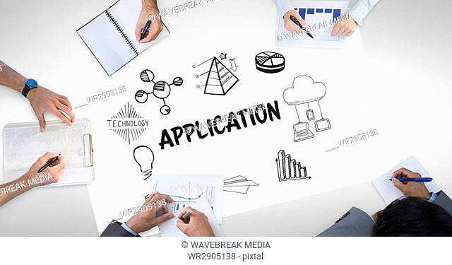 Cropped image of business people working with application icons on paper