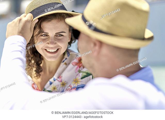 couple, sunhat, vacations, happiness, toothy smile