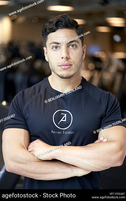 Portrait of muscular-built man in gym