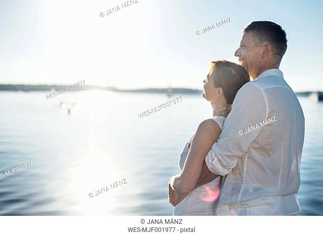 Couple enjoying sunlight at Lake Cospuden