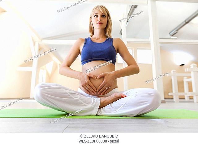 Prenatal yoga, Lotus asana, woman forming heart with hands