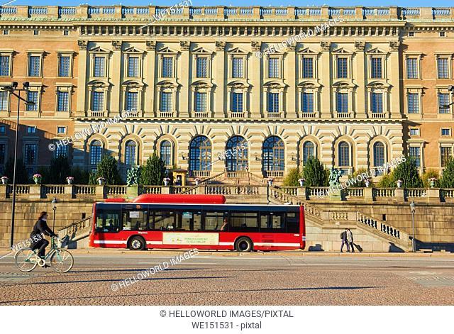 Bus and cyclist passing the Royal Palace (Kungliga Slottet) Gamla Stan, Stockholm, Sweden, Scandinavia