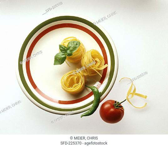 Tagliatelle with pepperoni, tomato and basil