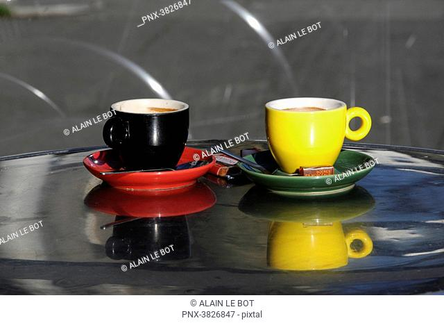 France, Nantes city, two coffee cups on a bistro table, coffee shop