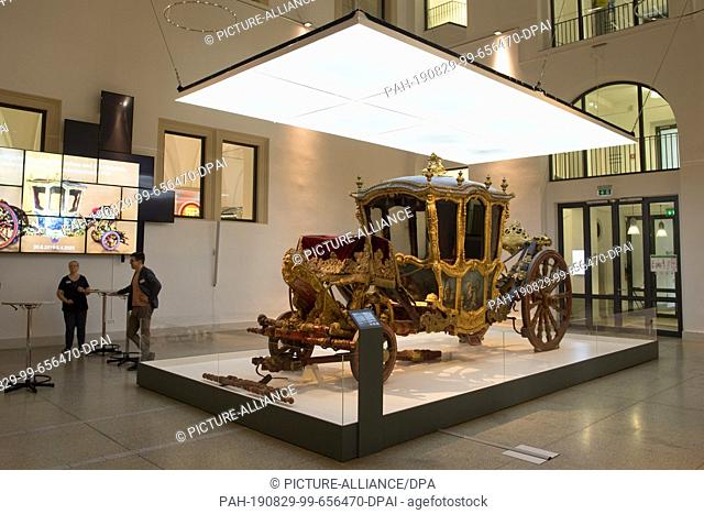 """29 August 2019, Saxony, Dresden: The magnificent carriage """"""""Grand Carrosse"""""""" from the early 18th century is on display in the Transport Museum in the exhibition..."""