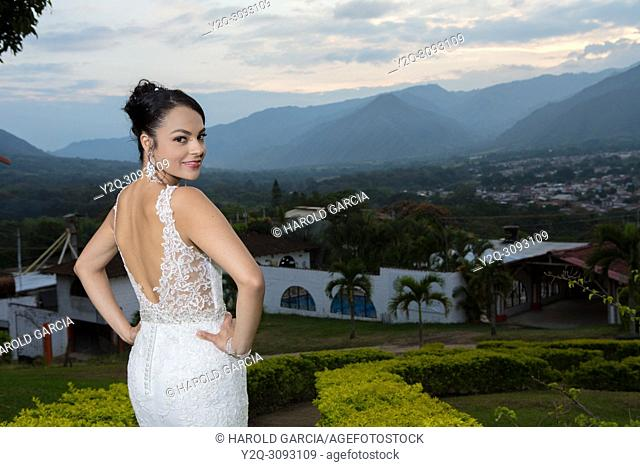 Gorgeous bride posing outdoors in a beautidul wedding dress
