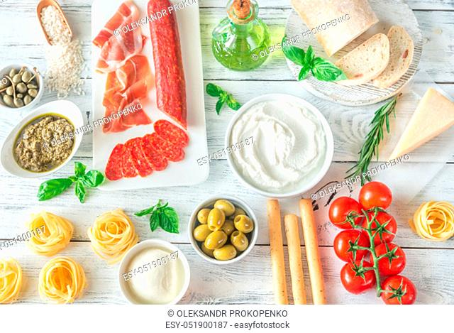Assortment of Italian foods on the wooden table