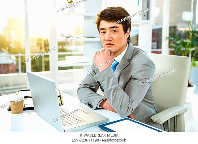 Serious Asian man sitting