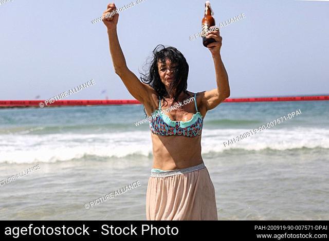 19 September 2020, Israel, Tel Aviv: Awoman takes part in a protest at the Beach of Tel Aviv, against the Coronavirus lockdown.
