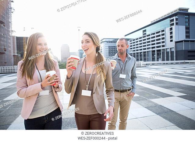 Three colleagues having break time