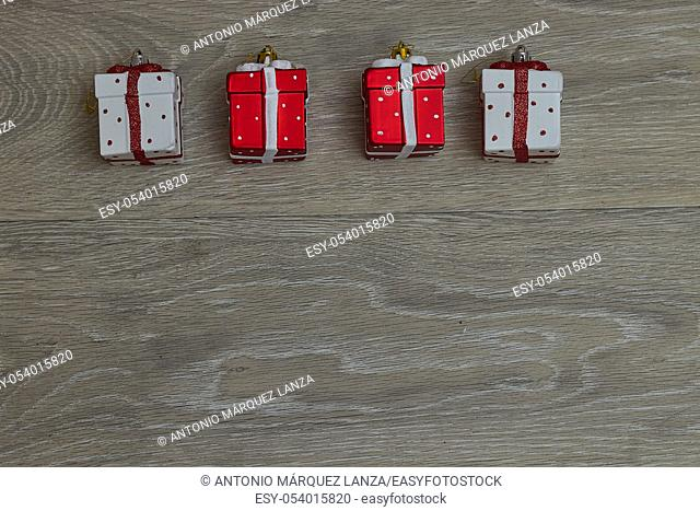 christmas ornaments over wood, gifts