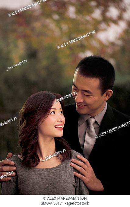 Young couple looking at each other and smiling