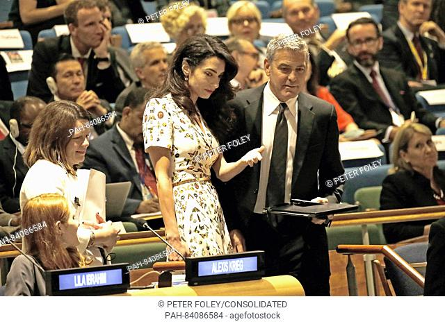 Lebanese-British lawyer, Amal Clooney (L) and her husband United States actor George Clooney attend a Leaders Summit for Refugees during the United Nations 71st...