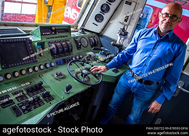 16 July 2020, Mecklenburg-Western Pomerania, Mukran: BPS managing director Ulrich Rudler is standing in the driver's cab of a class 181 electric locomotive...