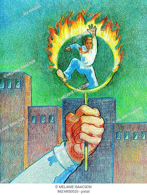 A businessman jumping through a ring of fire