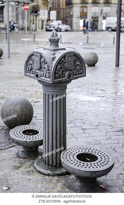 View of an urban fountain closed to Mayor street, Madrid city, Spain