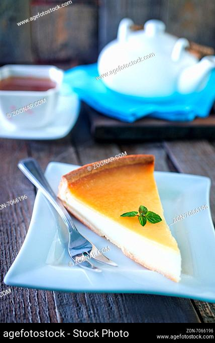 cheesecake on white plate and on a table