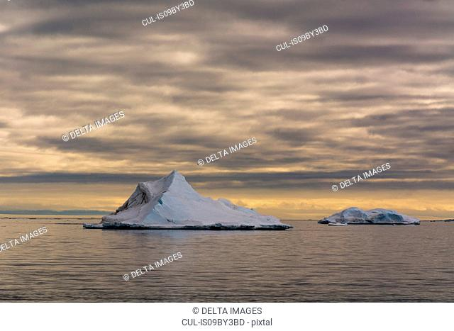 Seascape with icebergs and storm clouds, Vibebukta, Austfonna, Nordaustlandet, Svalbard, Norway