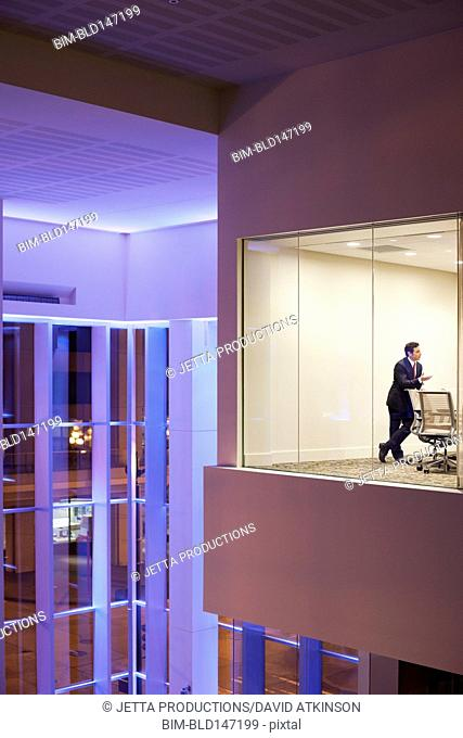 Caucasian businessman standing in modern conference room