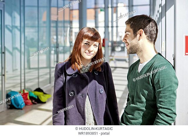 Portrait of young couple in airport building