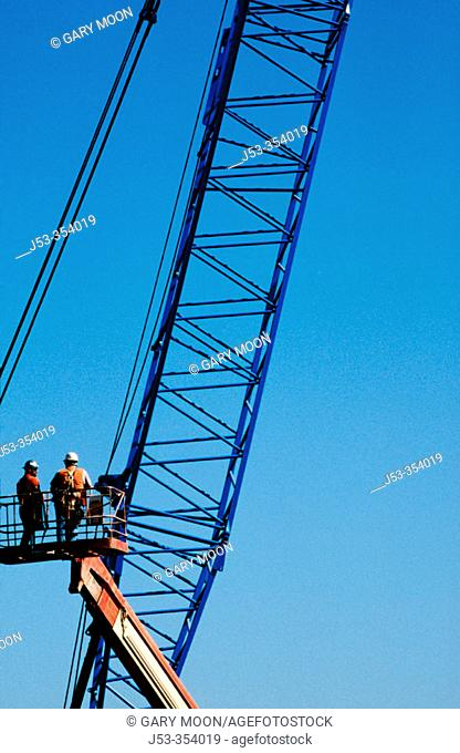 Workers in manlift examining damaged rebcage. I-880 Cypress project. Oakland, California. USA