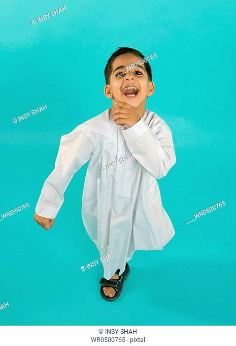 Boy 8-9 gesturing, elevated view, portrait