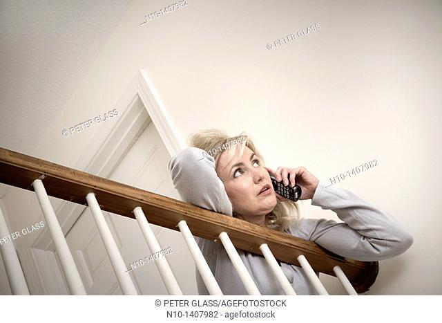 Middle-age blond woman talking on her telephone