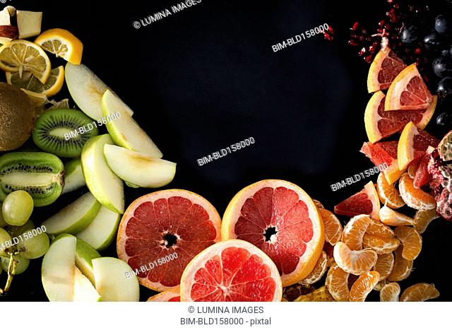 Close up of variety of sliced fruit
