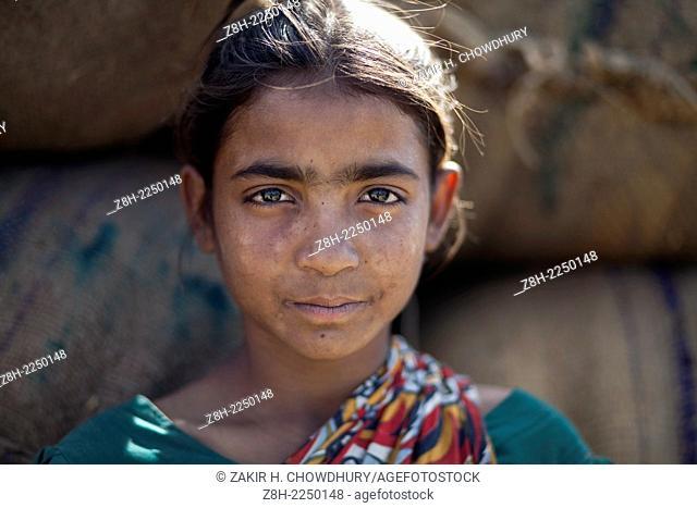 portrait of a working teenage girl in Bangladesh