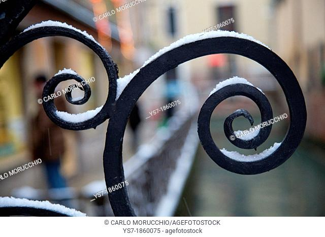 Venice bridge wrought iron railing covered with snow, Venice, Italy, Europe