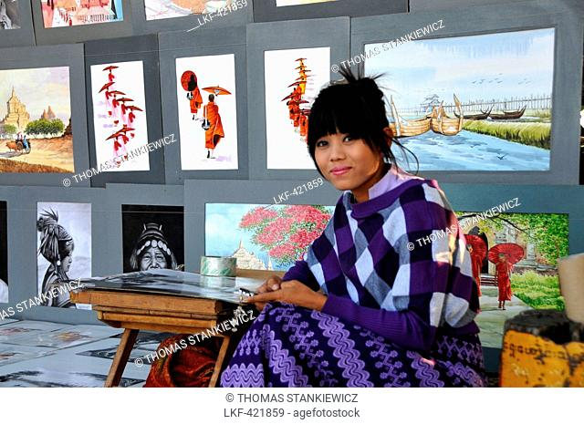 Artist with her works on the U Bein bridge, Amarapura near Mandalay, Myanmar, Burma, Asia