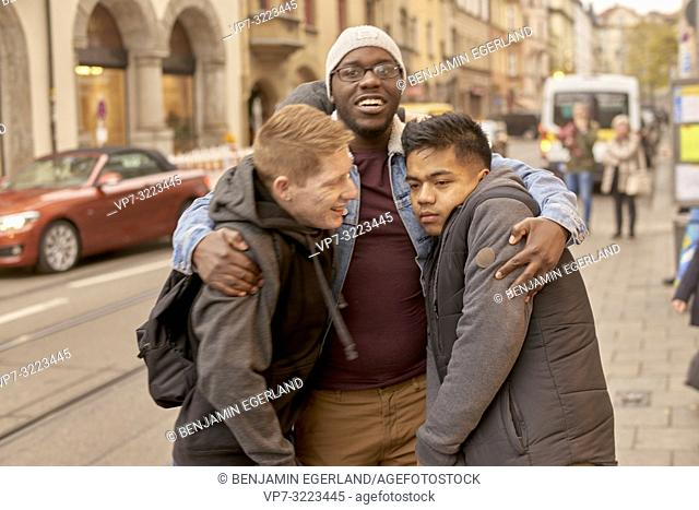 young men in city, in Munich, Germany