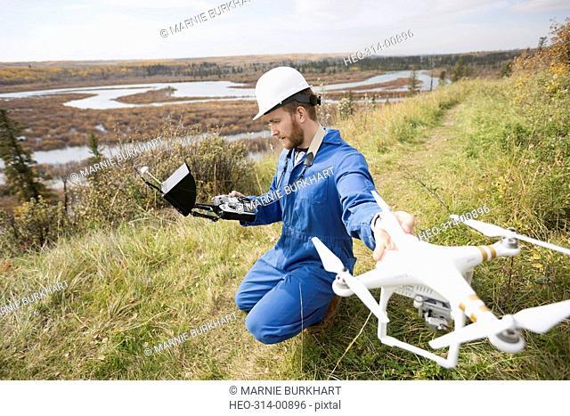 Surveyor with drone equipment on hillside
