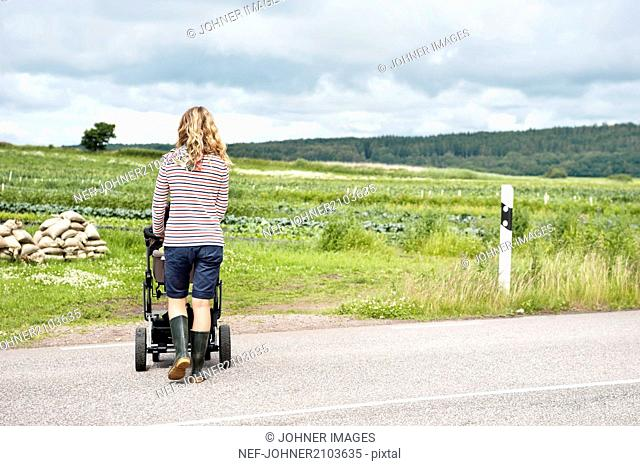 Woman walking with pram