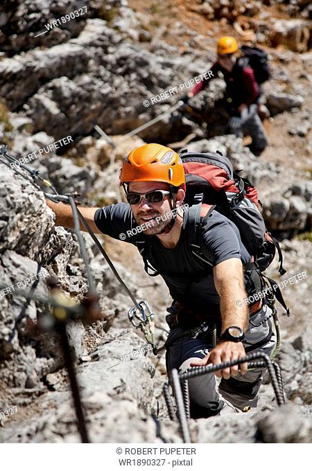 Two alpinists rock climbing, Innsbruck route, Tyrol, Austria