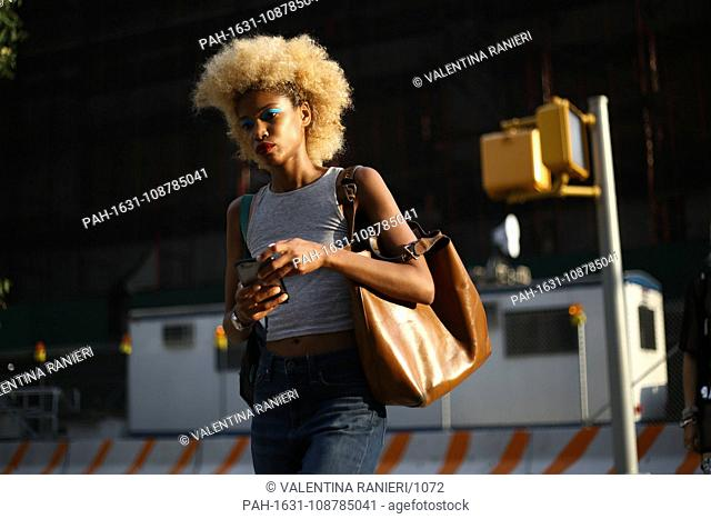 A chic showgoer walking outside of the Discount Universe runway show during New York Fashion Week - Sept 6, 2018 - Photo: Runway Manhattan ***For Editorial? Use...